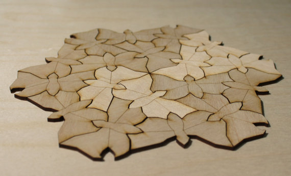 M C Escher butterflies carved from thin plywood by a laser